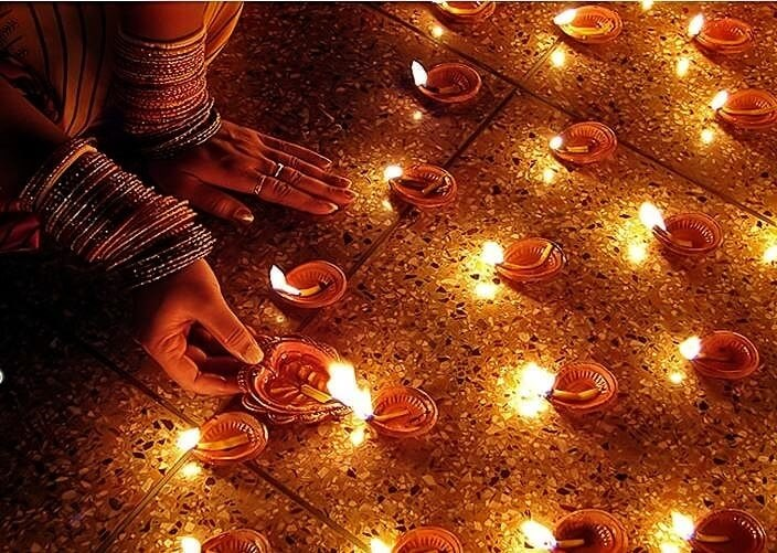 Lighting diyas on dhanteras