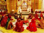 Women performing puja on dhanteras