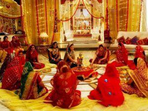 Women performing puja on dhanteras